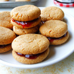 Peanut Butter and Jelly Sandwich Cookies- Everyone will ask you where you bought these adorable little sandwich cookies. And the recipe couldn't be simpler!