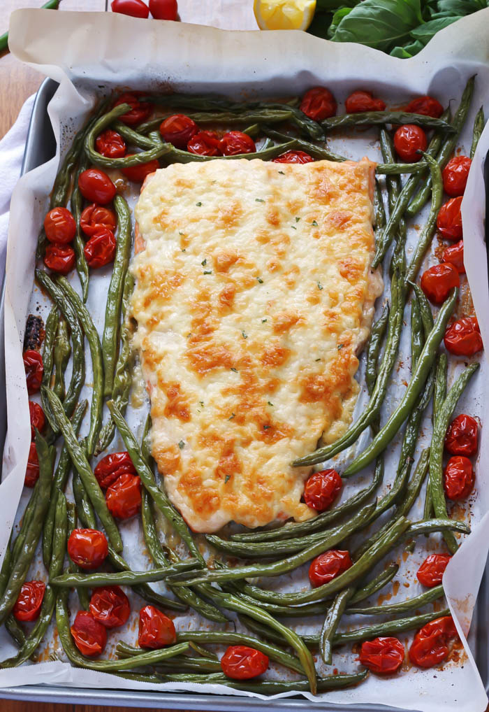 Cheesy Sheet Pan Salmon- a complete meal all in one! A juicy piece of salmon covered in cheese. Your family is guaranteed to love this recipe! passthechallah.com